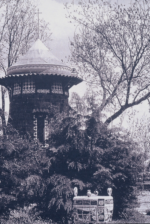 This towered building, no longer in existence, had a small one-story building attached to it. In the tower was a library, and was a place for solitude and contemplation. The garden was densely populated with trees and shrubbery, creating a place of mystery and discovery. Photo courtesy of Urrutia Photo Collection.