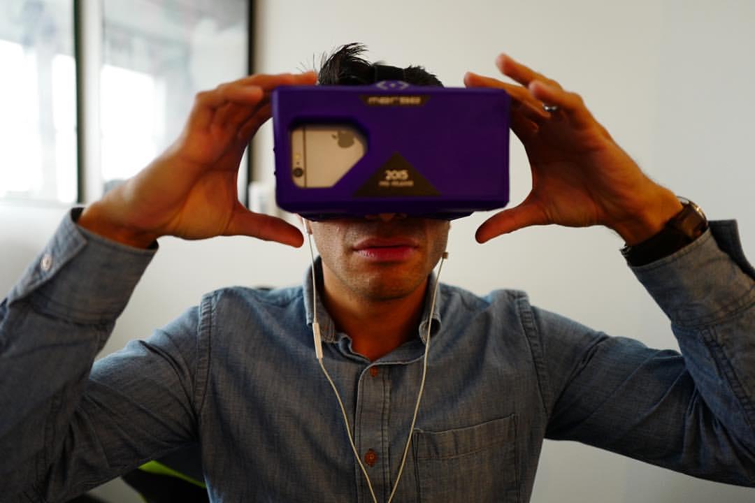 Rivard Report Marketing Director Jaime Solis tries virtual reality using a Merge VR Goggles. Photo by Scott Ball.