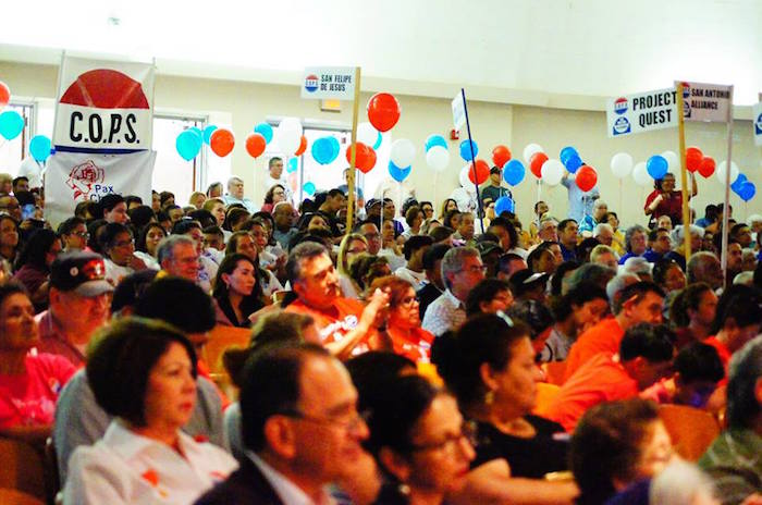 Members of Sacred Heart Catholic Church listen to the elected officials' commitments.  Photo by Sean Encino.