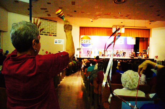Virginia Carrillo of St. Leo the Great cheers as the assembly begins. Photo by Sean Encino.
