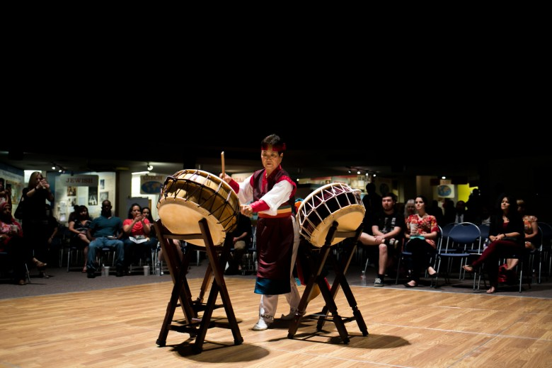 Mrs. Yang performs a Korean drum dance. Photo by Kathryn Boyd-Batstone.