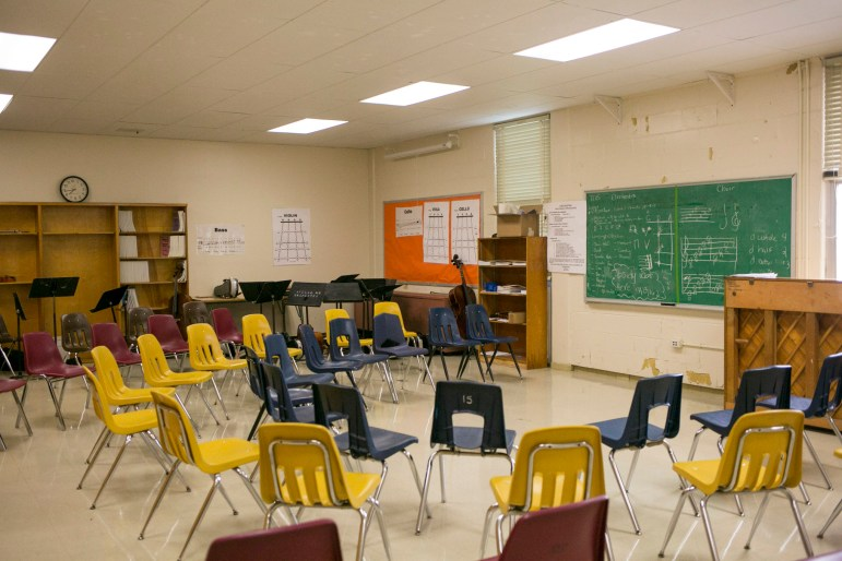 The choir and orchestra classes at Tafolla Middle School are currently being held in an unused classroom because the air conditioning is out in the choir room. Photo by Kathryn Boyd-Batstone.