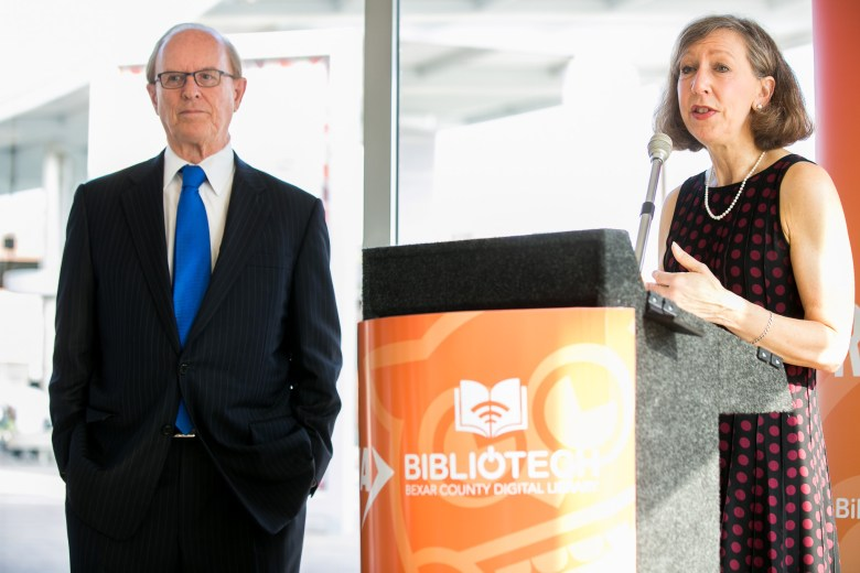BiblioTech Administrator Laura Cole and Bexar County Judge Nelson Wolff speak about the many e-books available. Photo by Kathryn Boyd-Batstone.