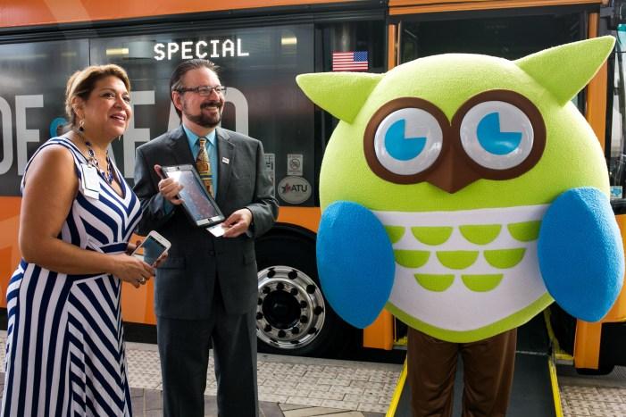 VIA Metropolitan Transit President/CEO Jeffrey C. Arndt poses with BiblioTech mascot Techolote. Photo by Kathryn Boyd-Batstone.