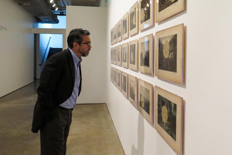 "Councilman Roberto Treviño (D1) observes the art around him during an exhibit preview of ""SATX/MX: Un Viaje Lleno de Cultura."" Photo by Rocío Guenther."