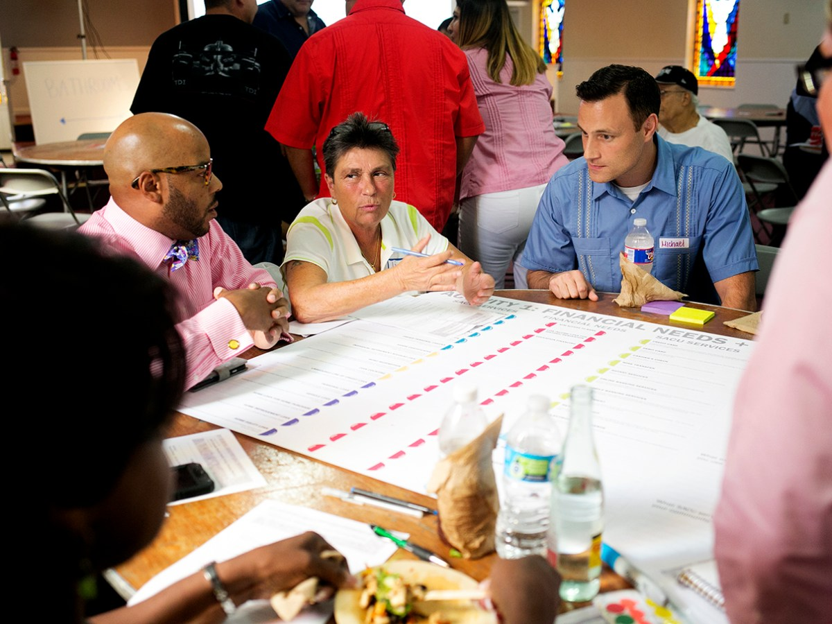 Eastside community members talk about how San Antonio Credit Union can best service the needs of the community with their new Eastside branch. Photo by Kathryn Boyd-Batstone.