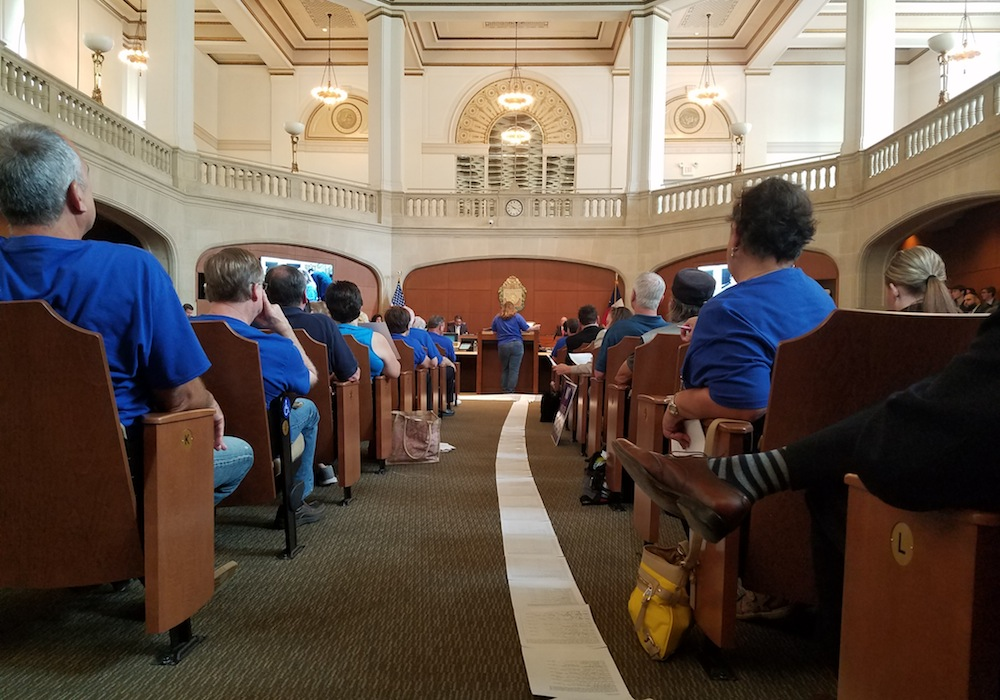 Residents that live near I-10 West collected thousands of signature and rolled them out onto the floor in City Council chambers. Photo by Iris Dimmick.