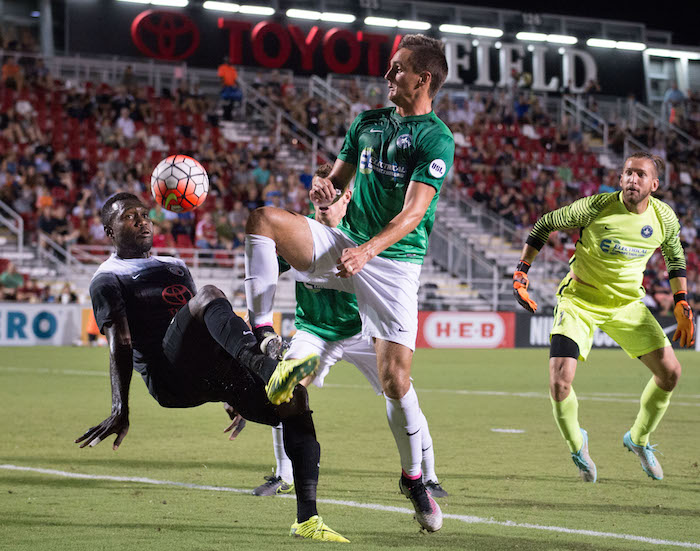 San Antonio FC's Franck Tayou (left) fights for the ball in a match against Saint Louis FC Saturday night at Toyota Field. Photo by Darren Abate for USL.