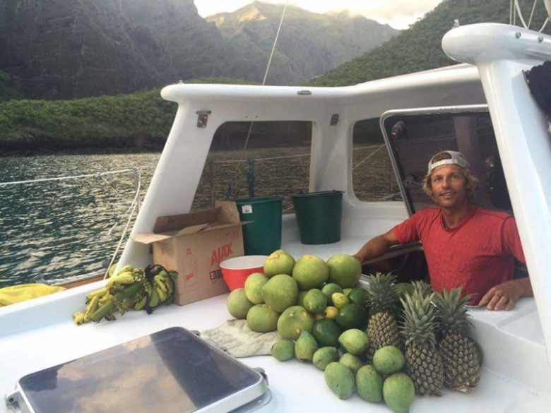 Ryan with a good haul of fruit in Daniel's Bay. Photo by Everett Redus.