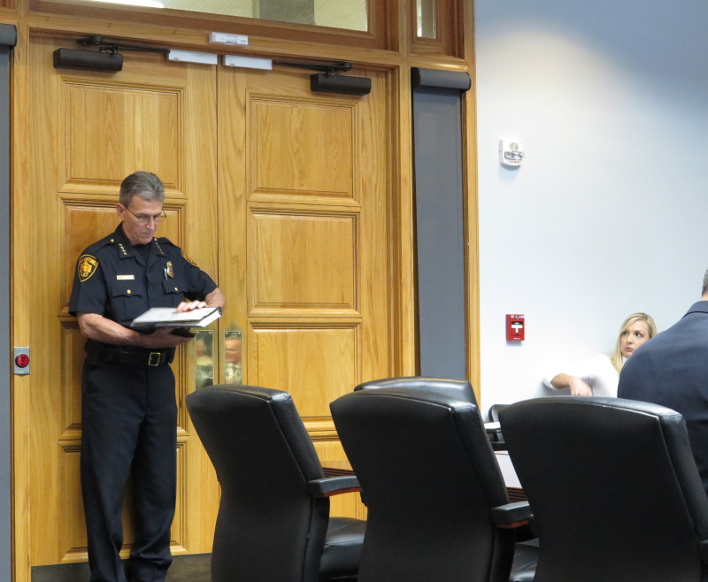 Police Chief William McManus arrives to the media room at City Hall to talk about ways to combat panhandling in the city. Photo by Rocío Guenther.
