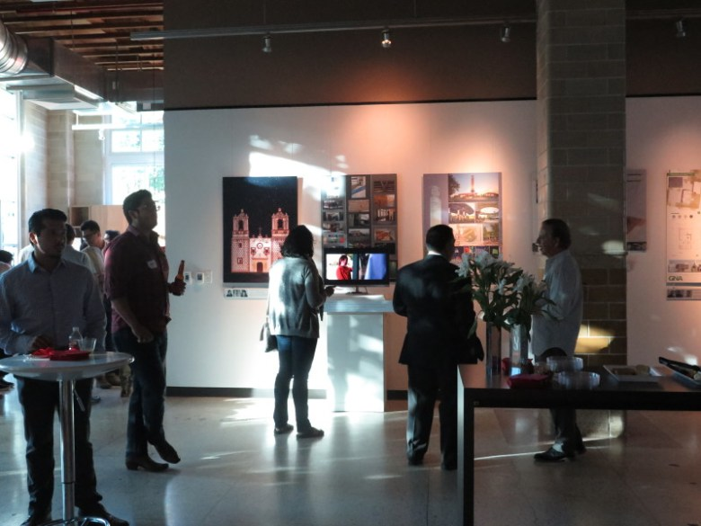 Attendees view design work from professional firms and students at AIA's Latinos in Architecture Nexo exhibit. Photo by Rocío Guenther.