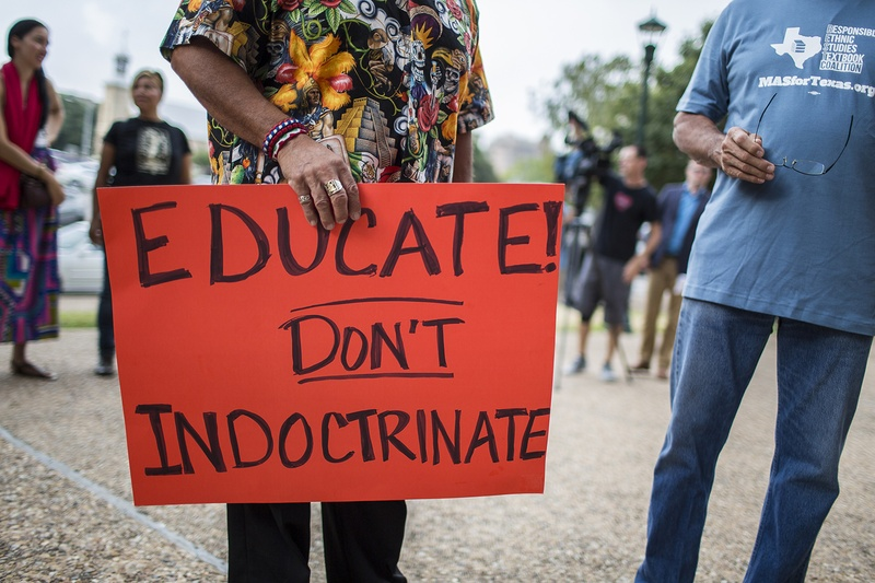 Hispanic activists, advocates and elected officials protested a proposed Mexican-American studies textbook on Tuesday ahead of the Texas Board of Education's first public hearing on the text. Photo by Martin do Nascimento for The Texas Tribune.