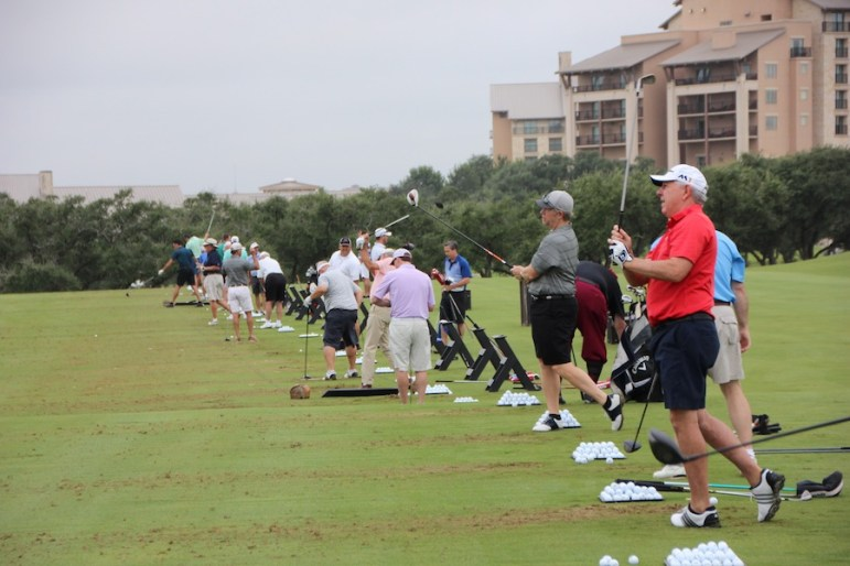 Players, including World Golf Hall of Famer Hale Irwin (right), warm up on the range. Photo courtesy of Pro Link Sports.