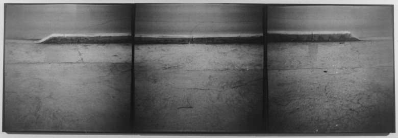 Untitled (Thin Curb), 1997, gelatin silver prints on paper mounted on wood panels, 48 x 144 in. Photo courtesy of Kent Rush.