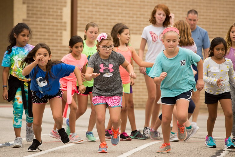 Girls take off running during the 'Girls on the Run' program at Cambridge Elementary. Photo by Scott Ball.