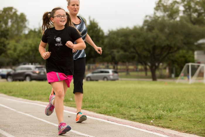 Ava, 8, runs down the track during the 'Girls on the Run' program which encourages children to run after school. Photo by Scott Ball.