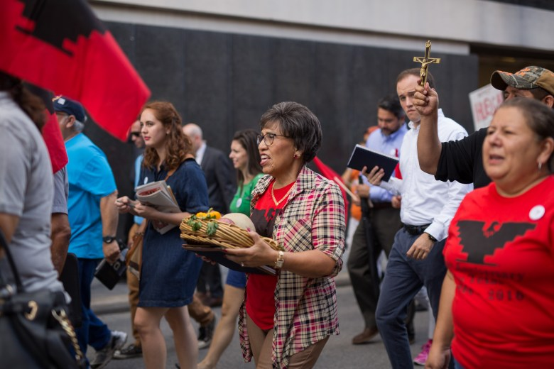 Hundreds of people marched through downtown San Antonio on Labor Day to call for higher wages. Photo by Scott Ball.