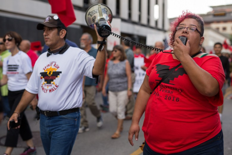 Activist Barbie Hurtado (right) calls for justice as the march continues toward Milam Park. Photo by Scott Ball.