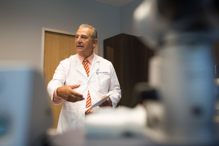 Dr. Art Medina explains the technology behind the new innovative procedure. Photo by Scott Ball.