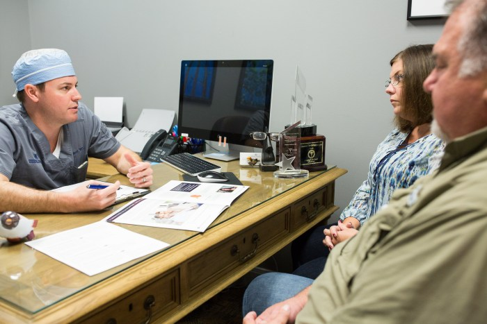 Dr. Gregory Parkhurst consults with patient Marsha Spreeuwers and her husband Fred Spreeuwers. Photo by Scott Ball.