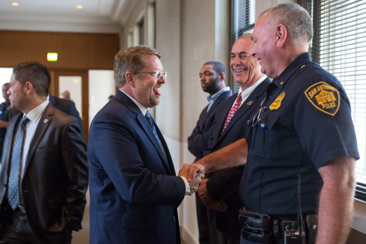 San Antonio Police Officers Association President Mike Helle shakes hands with a San Antonio Police Officer following the announcement of an approved contract with the City of San Antonio. Photo by Scott Ball.