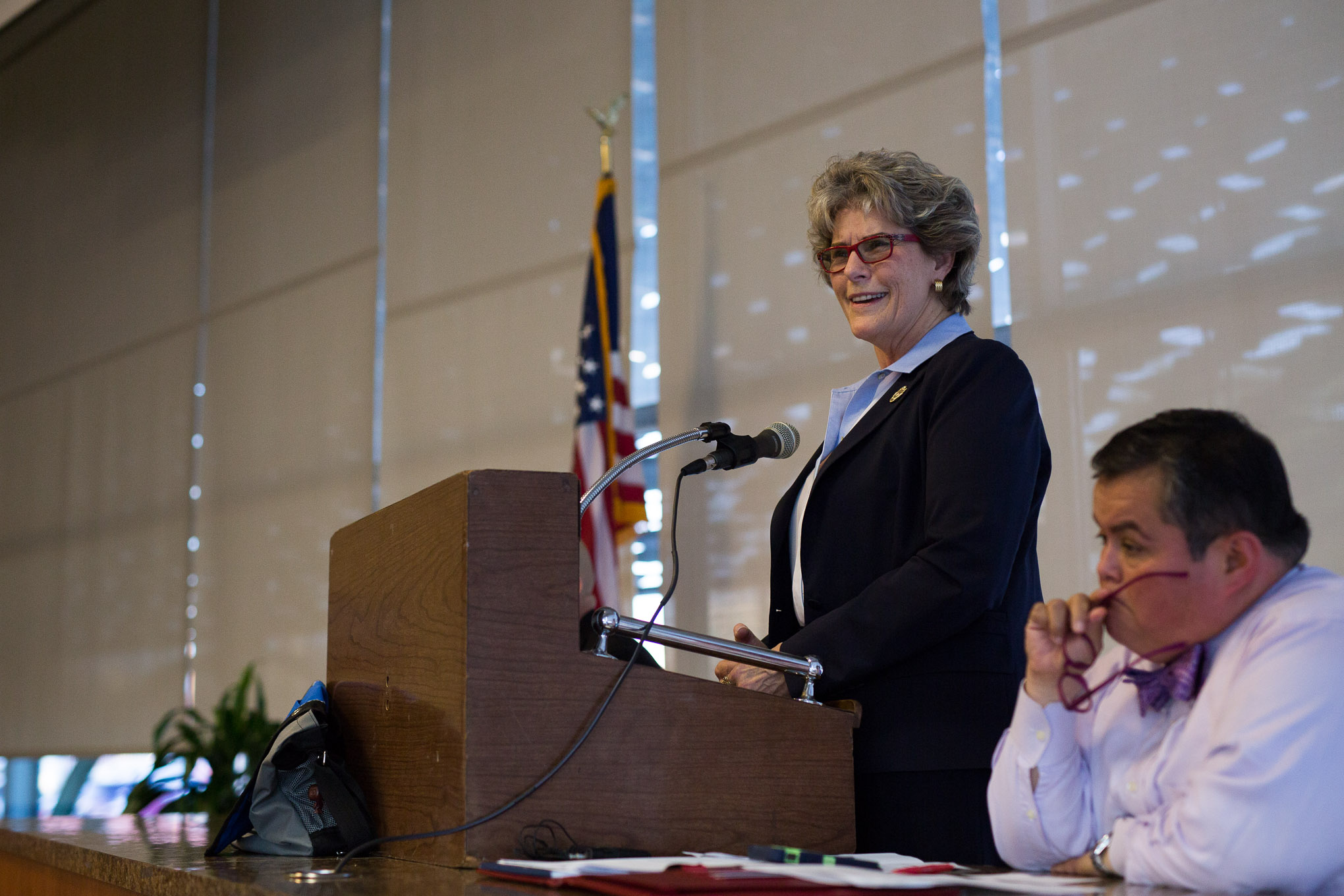 Sheriff Susan Pamerleau reacts to the large audience attendance of her opponent, Javier Salazar. Photo by Scott Ball.