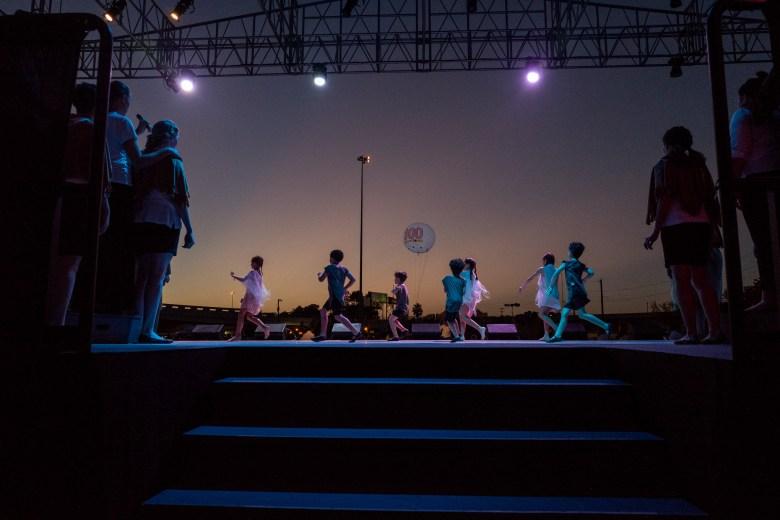 Children performers run across the stage during Las Fundaciones de Béjar. Photo by Scott Ball.