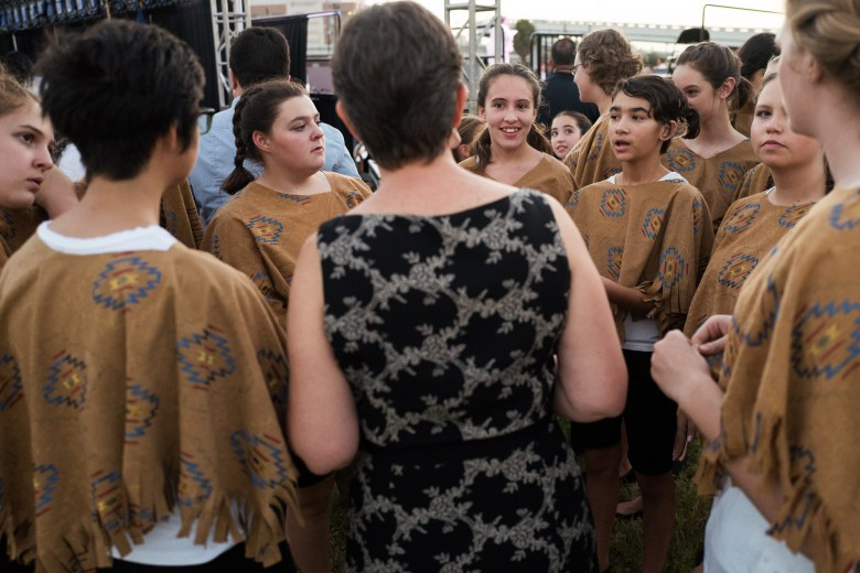 Children's Chorus of San Antonio have a team huddle before their performance. Photo by Scott Ball.