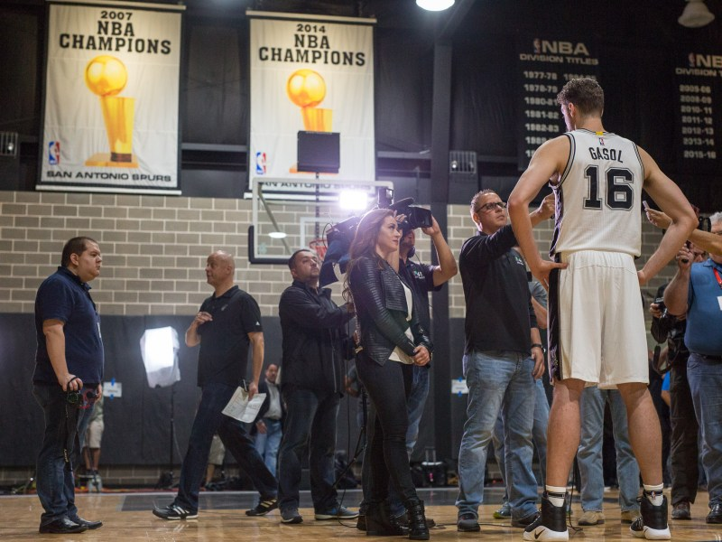 Recently acquired Spurs Center Pau Gasol performs an interview in Spanish for reporters. Photo by Scott Ball.