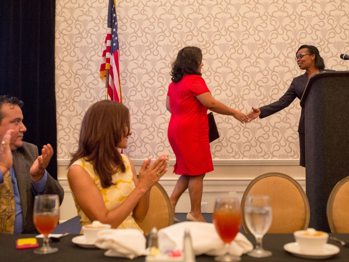 Mayor Ivy Taylor (right) extends her hand as she welcomes Councilwoman Rebecca Viagran (D3) to the stage. Photo by Scott Ball.