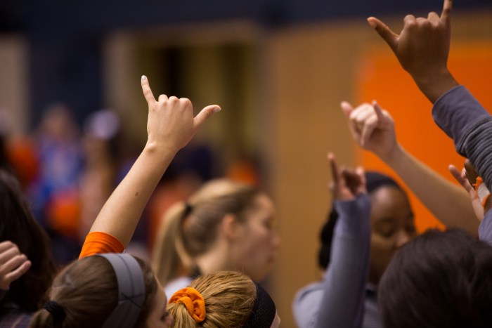 UTSA holds up their hands in solidarity before returning to the game.  Photo by Scott Ball.