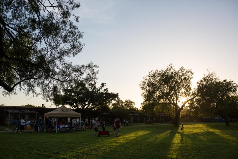 Attendees flock across the field that fills the interior walls of Mission José. Photo by Scott Ball.