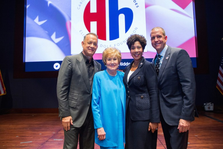 (from left): Tom Hanks and Sen. Elizabeth Dole with Harriett Dominique and Justin Schmitt from USAA. Photo by Lisa Nipp.