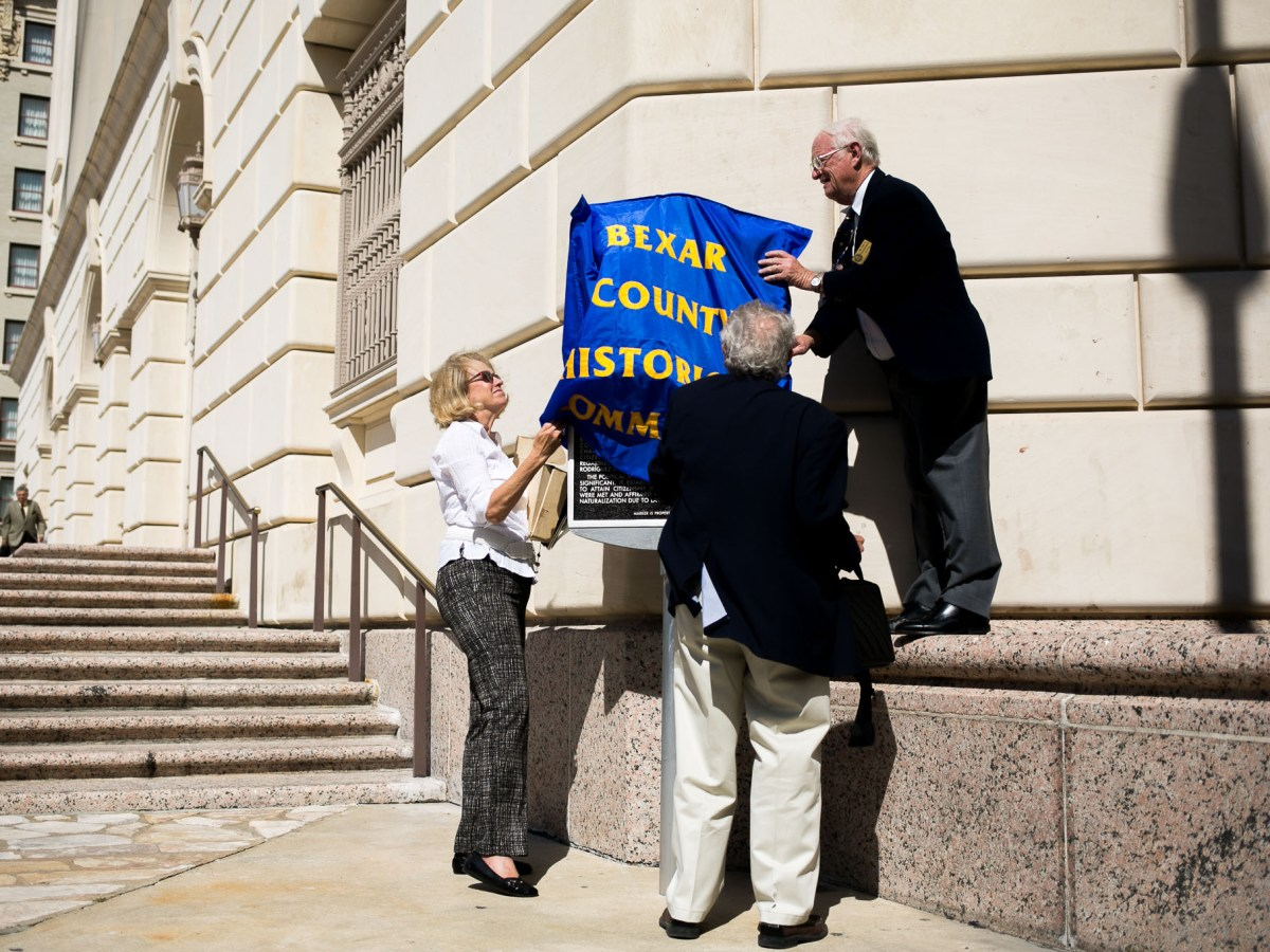 Bexar County Historical Society members cover the historical plaque before the unveiling. Photo by Kathryn Boyd-Batstone.