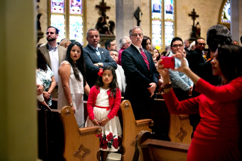 Red Mass attendees turn to watch Archbishop Gustavo García-Siller proceed down the aisle. Photo by Kathryn Boyd-Batstone