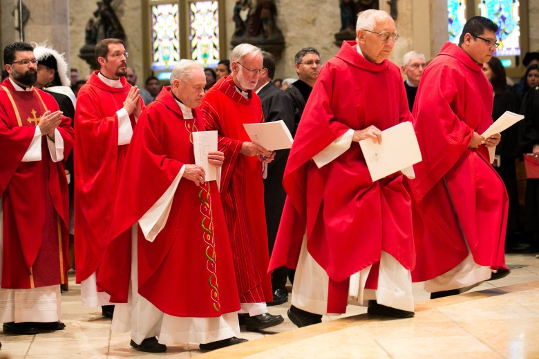 Priests of the Archdiocese of San Antonio Deacons done red robes in honor of Red Mass. Photo by Kathryn Boyd-Batstone.