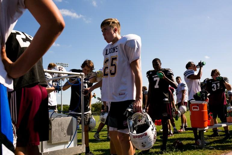 The San Antonio Christian High School football break for water during practice.