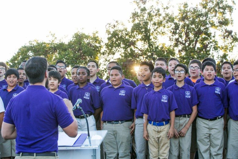 Students from the Young Men's Leadership Academy perform a song explaining their core values.