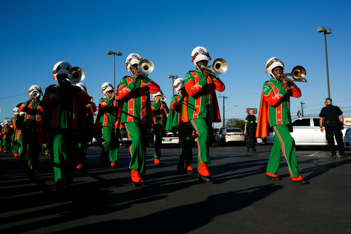 Sam Houston High School Marching Band performs at the W. W. White H-E-B store in celebration of its 50th birthday.