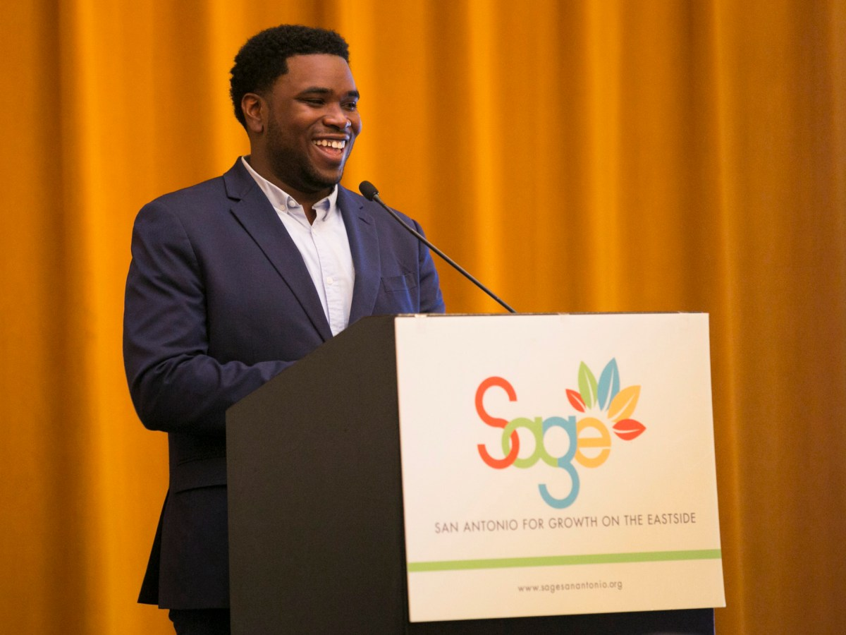 SAGE ?Director of Operations Akeem Brown welcomes everyone to the Eastside Business Briefing. Photo by Kathryn Boyd-Batstone.