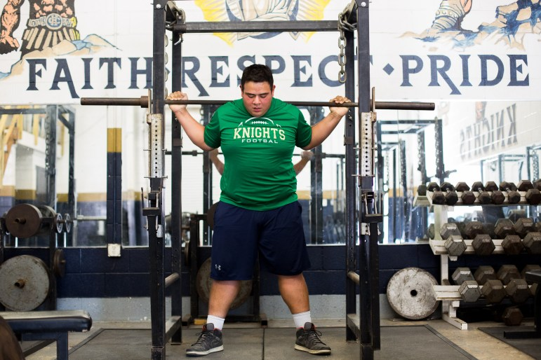 Holy Cross High School student Joseph Peña set a state record with a squat of 930 pounds last year.
