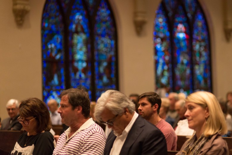 Friends and family of David Molak listen to the performance while honoring David's legacy.