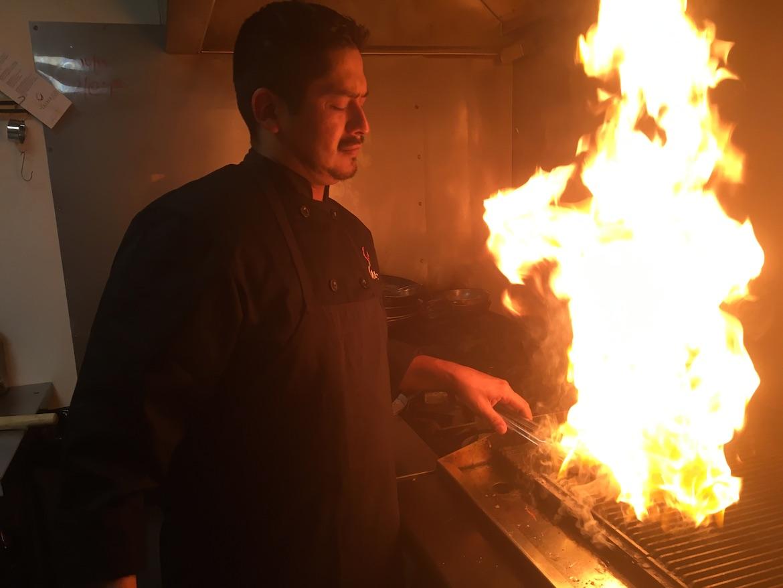 Executive Chef Edward Villarreal prepares food at Alberico Fine Wine.