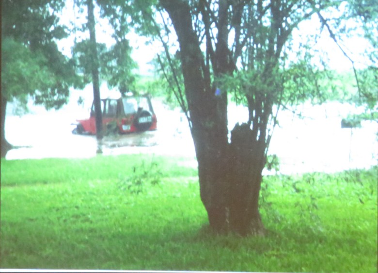 A picture of the flooding around the Blossom Park Neighborhood is projected during the first Drainage & Flood Control Community Bond Committee Meeting.