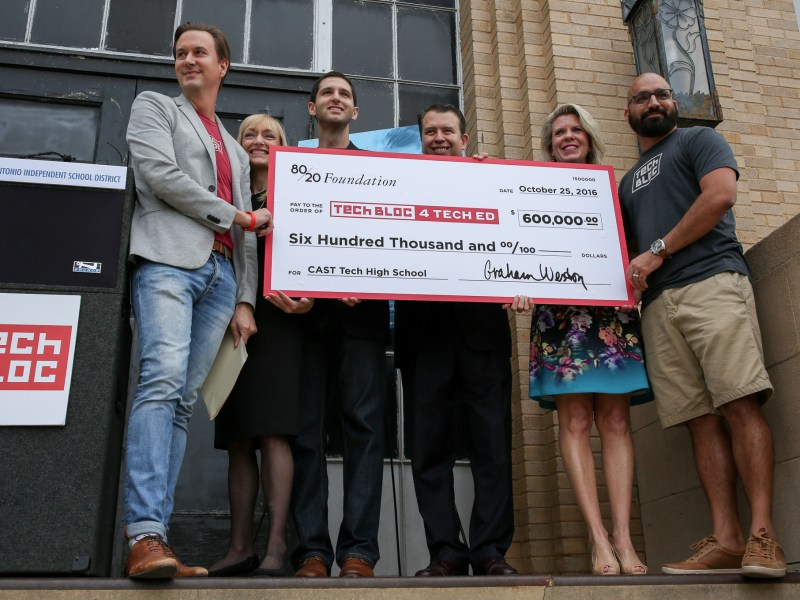 (Left to right) David Heard, Kelly Flieger, Scott Meltzer, Pedro Martinez, Kate Rogers, and Lorenzo Gomez hold a large check for the amount of $600,000.