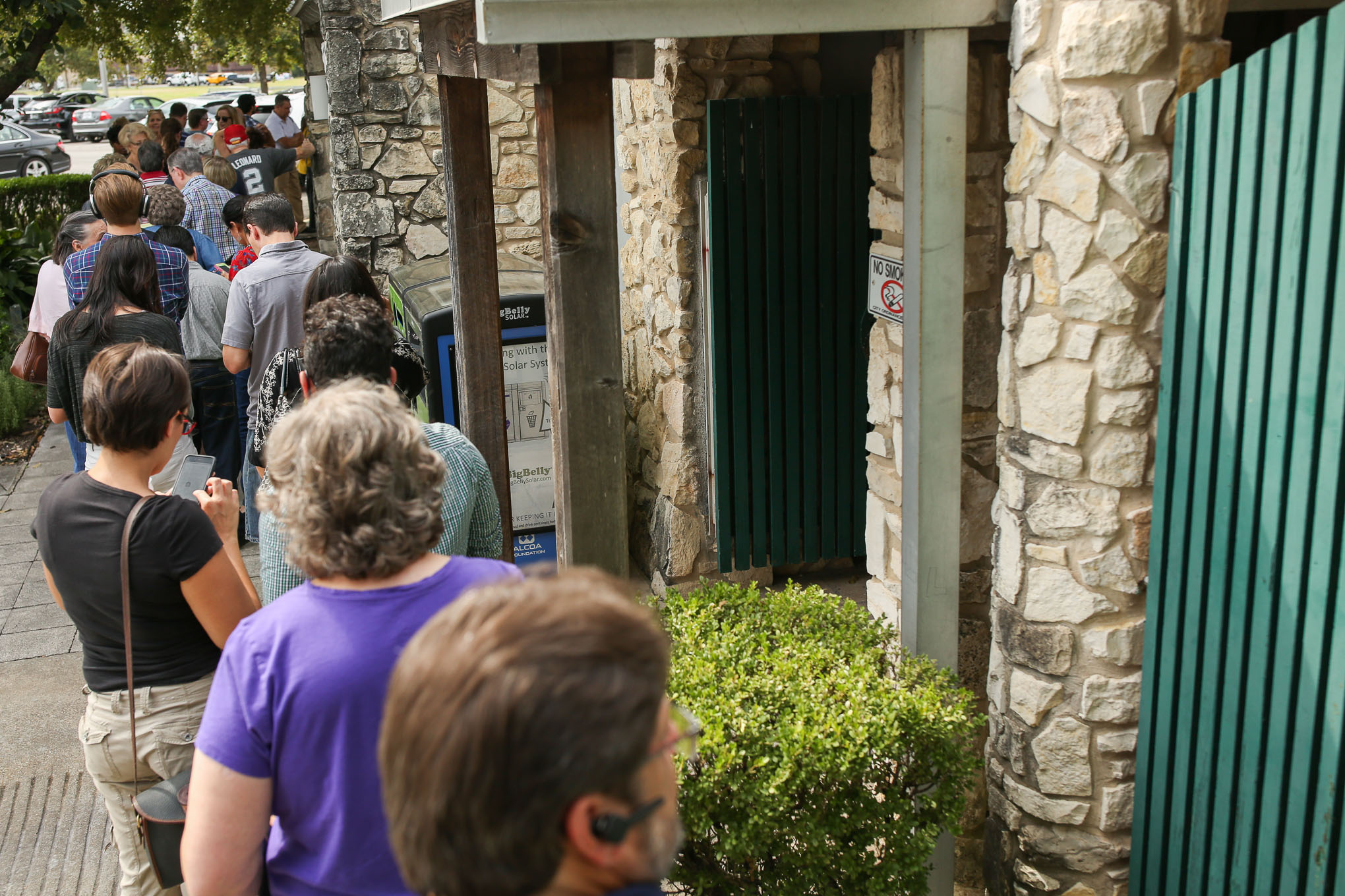 Early voters wait outside the Lion's Field Adult & Senior Activity Center on Broadway Street North of Downtown.
