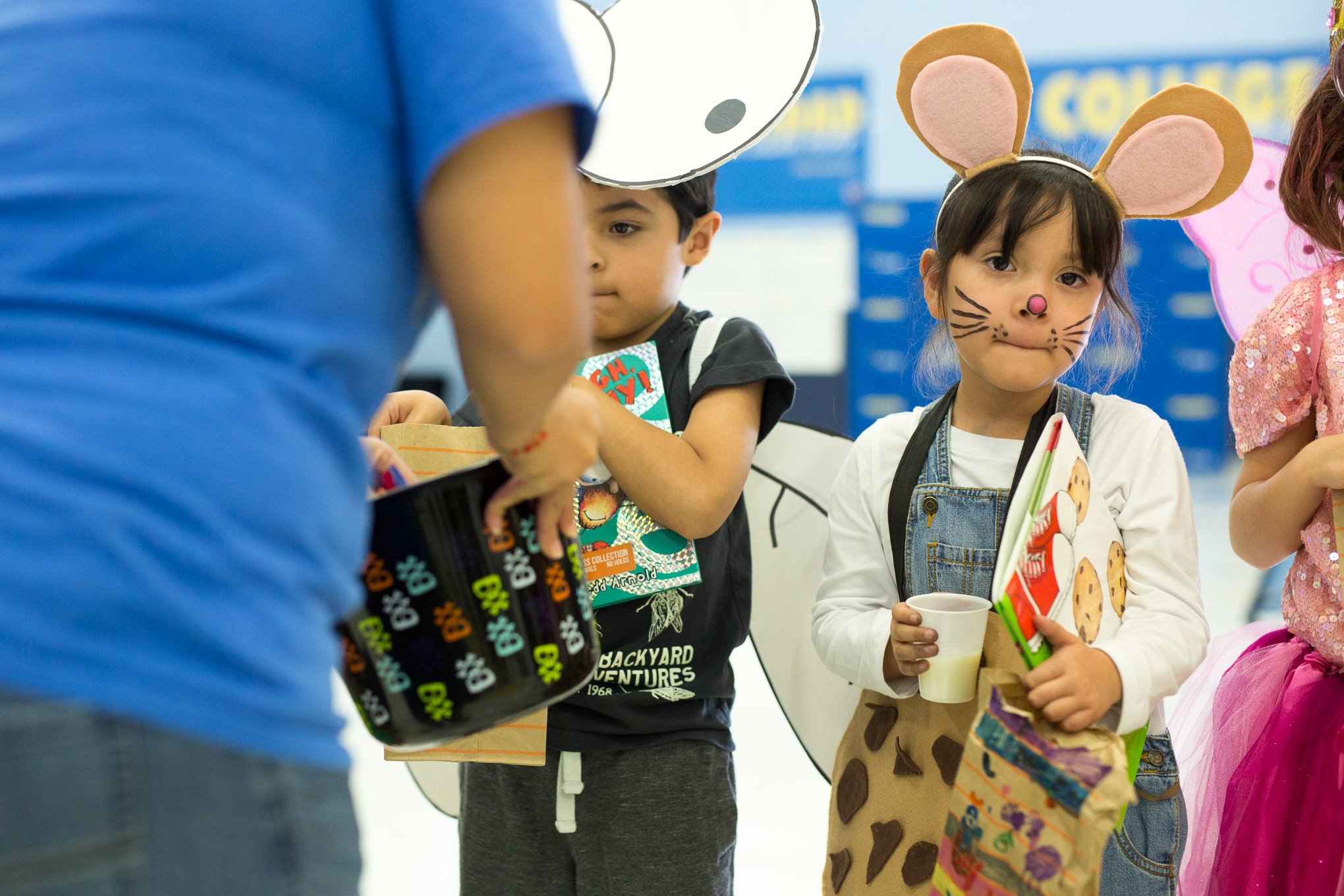 A student is dressed as 'If You Give a Mouse a Cookie' won the award for the cutest costume.