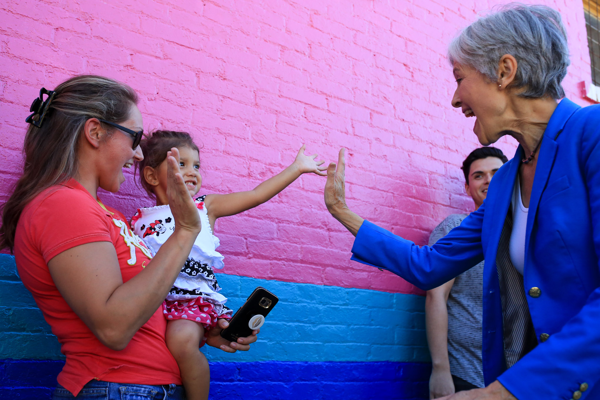Green Party Presidential Candidate Dr. Jill Stein meets and greets Brandy Nealey and her daughter Olivia, 2 years old as Stein arrives to the event.