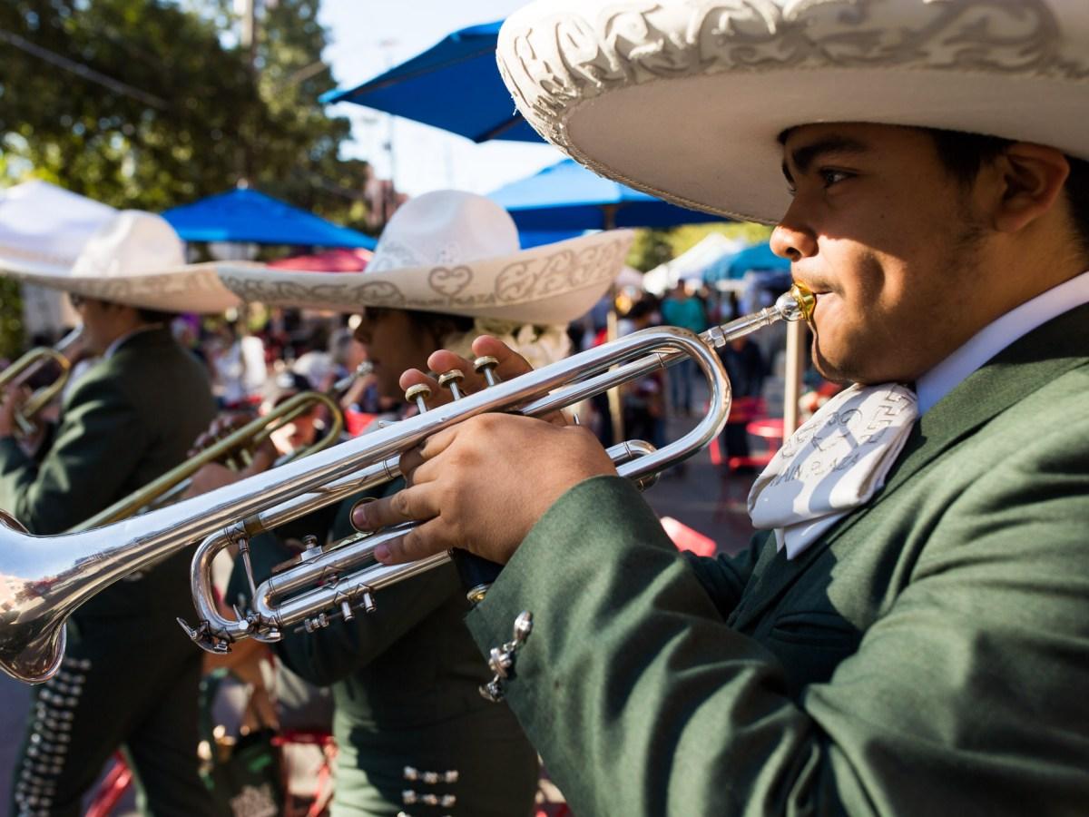 Mariachi Corazón De San Antonio performs as they the parade.