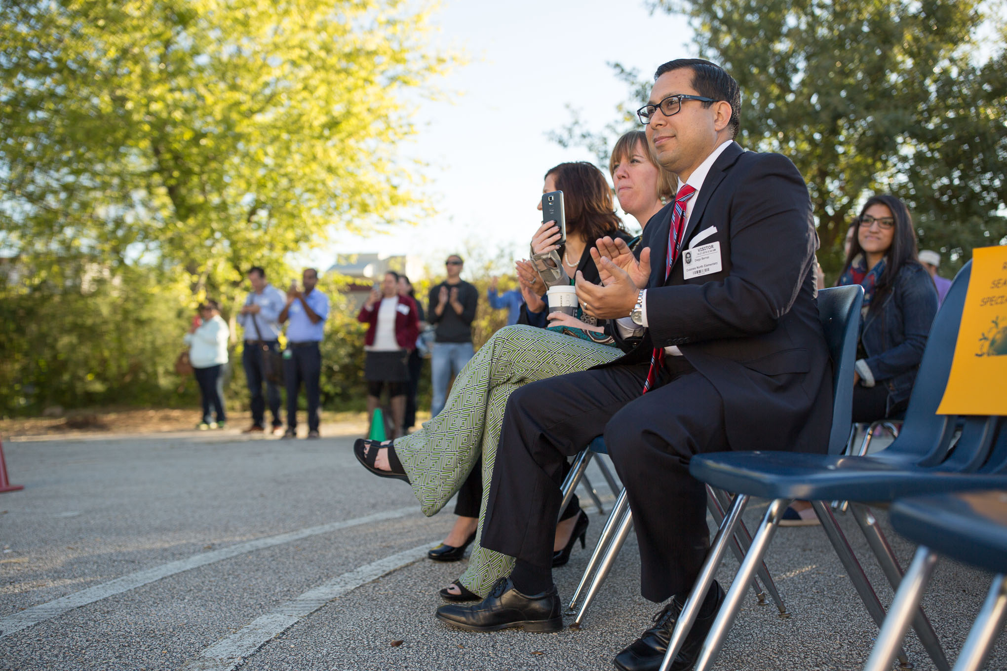 State Rep. Diego Bernal (D-123) applauds as students pass by at North Colonies Elementary.